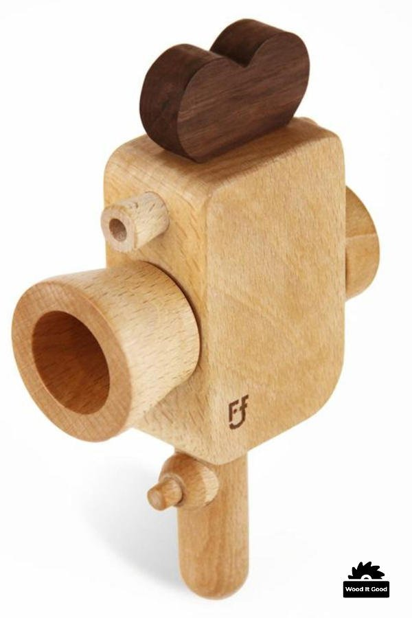 Old fashioned wooden movie camera toy.