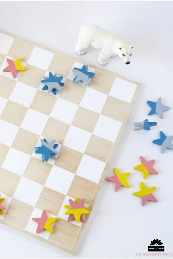 DIY wooden checkers set with star shaped wood pieces.