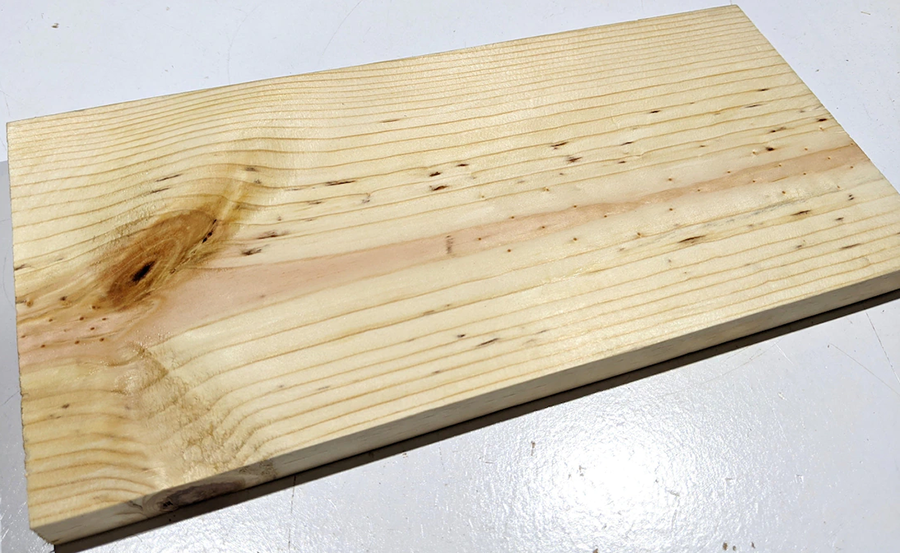This is a pine plank, a common type of wood.