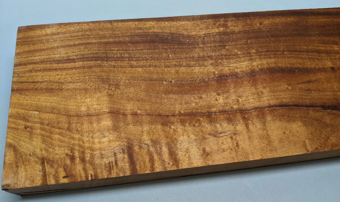 Koa is a beautiful, gold or reddish-brown color that's close to Mahogany, but a bit more rare.