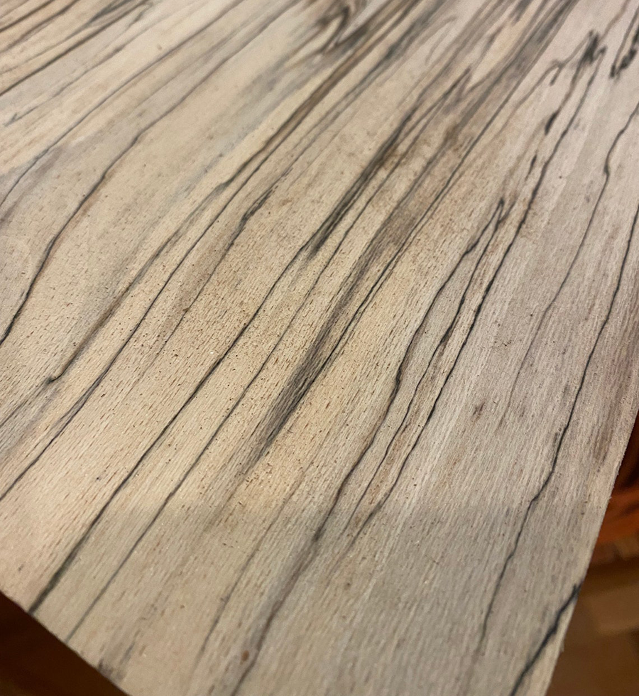 Sycamore is a beautiful, white wood with dark flecks, or stripes.
