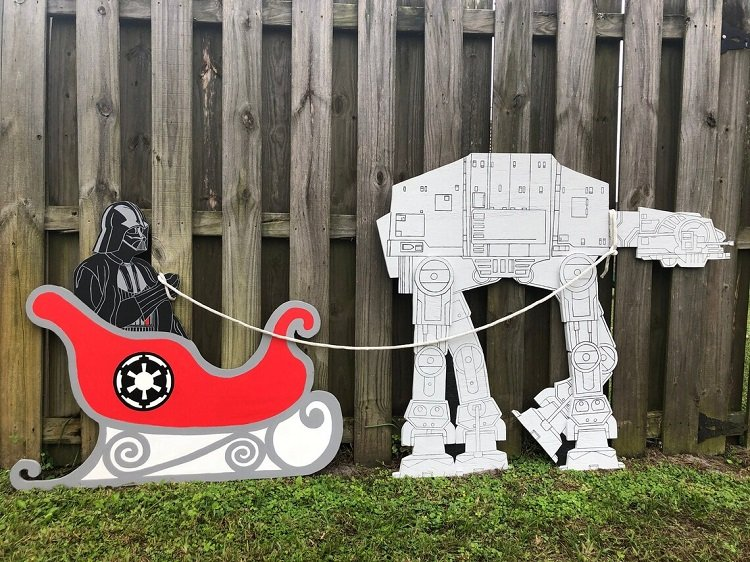 A Darth Vader sleigh with a robot walker reindeer, wooden Christmas yard decoration.