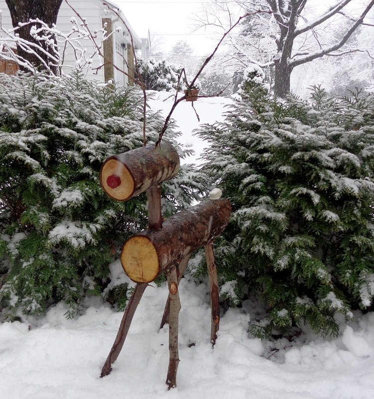 This is a Rudolph the Reindeer made out of firewood.