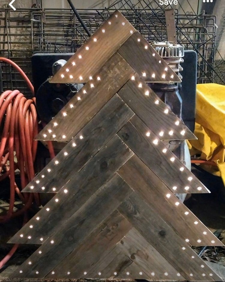 A pallet wood Christmas tree with lights for on your porch or in your yard.