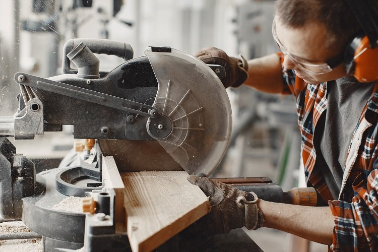 This is a picture of a man using a saw.