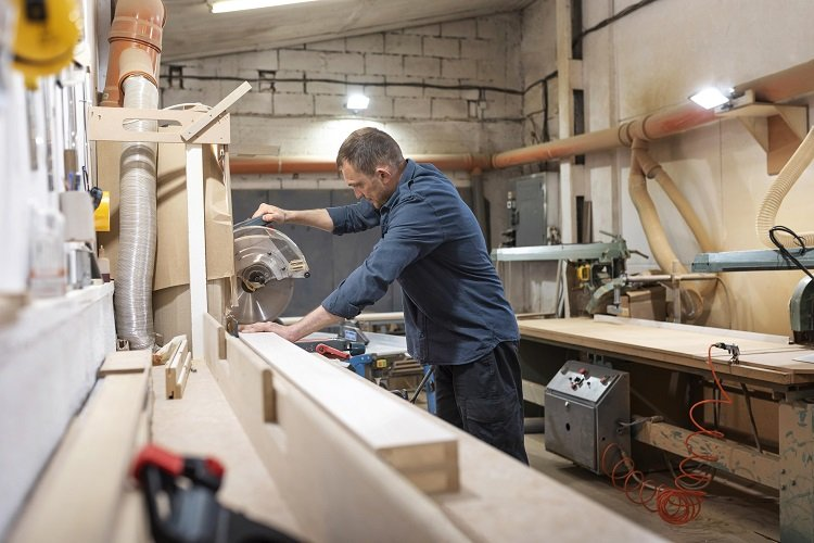 The image is a picture of a man working in his lovely workshop.